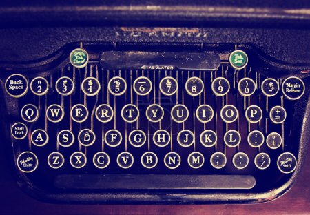Antique typewriter on wooden table