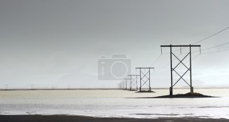 Electricity pylons over lagoon