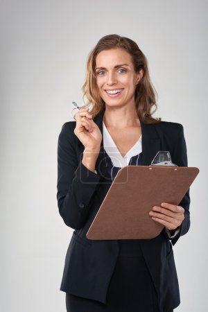 Smiling woman conducting market survey research