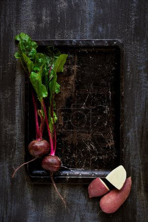 Fresh produce on dark distressed background