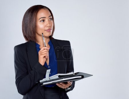 Determined business woman thinking of ideas