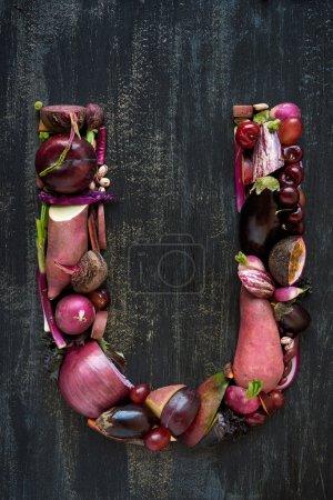 Alphabet letter made of purple vegetables