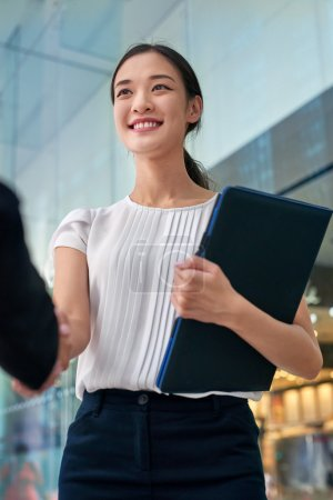 asian business woman handshake