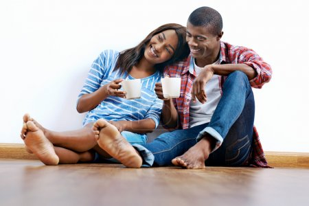 african couple on floor with coffee