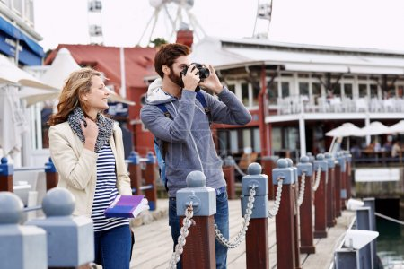 couple taking pictures on holiday