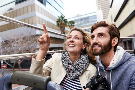couple on open top bus tour guide