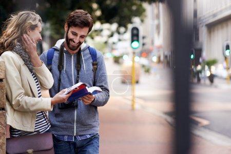 Travel couple walking around city