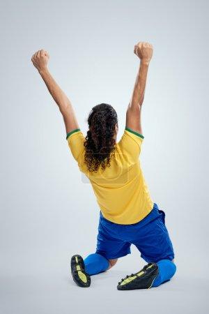 Celebrating soccer brazil man