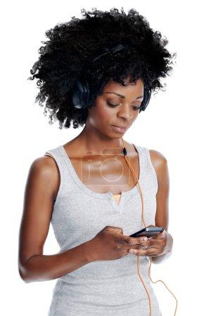 Black female listening to music