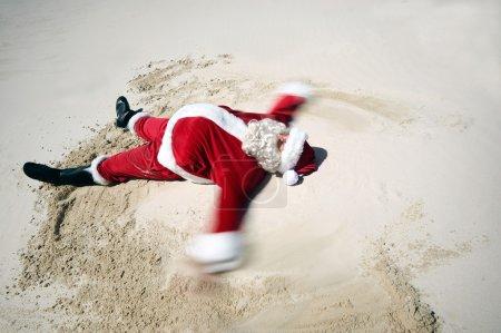 Father Christmas doing sand angel