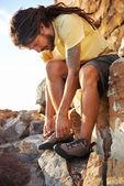 Hiker tying shoelaces