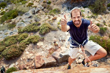 rock climber holding a thumbs up