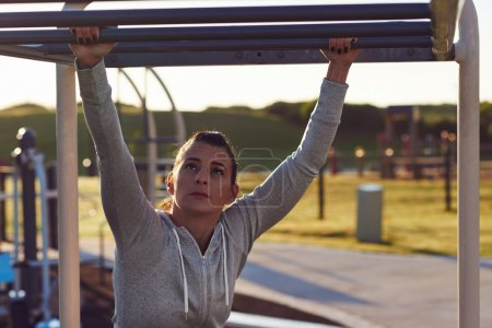 woman working out at outdoor gym