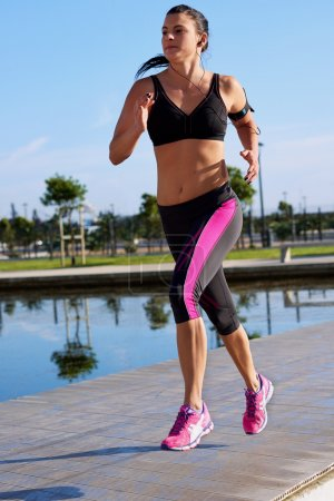 Woman fitness jogging in park