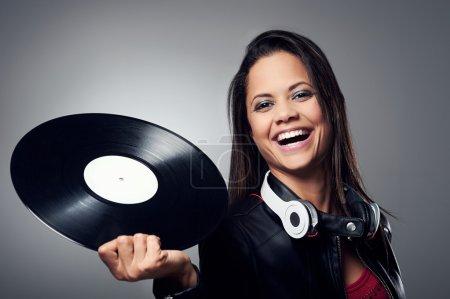 Woman dj with vinyl record and headphones
