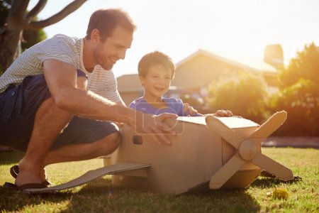 Son and dad with toy aeroplane