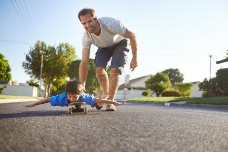 Boy learning to ride skateboard