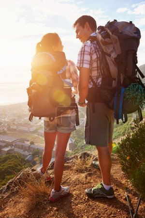 couple standing on hiking trail