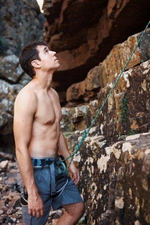 man starts his rock climbing