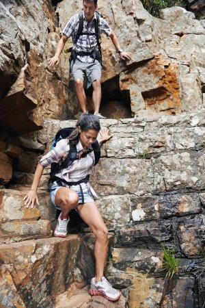 hiking man and woman climbing