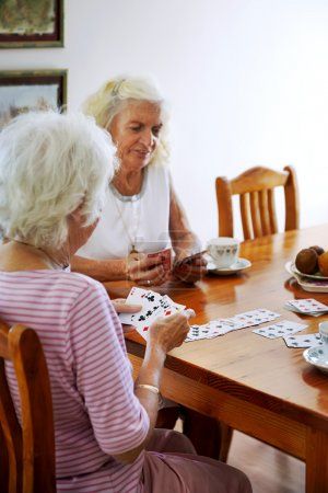 women playing a card game