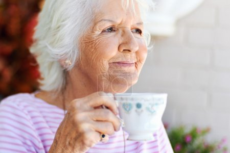 woman holding cup of tea