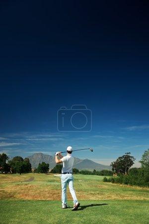 Golf shot on course in fairway