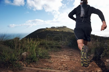 Trail running man on mountain