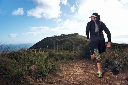 Trail running man on mountain