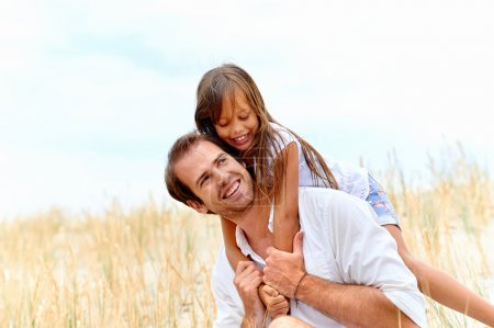 father and daughter have fun together