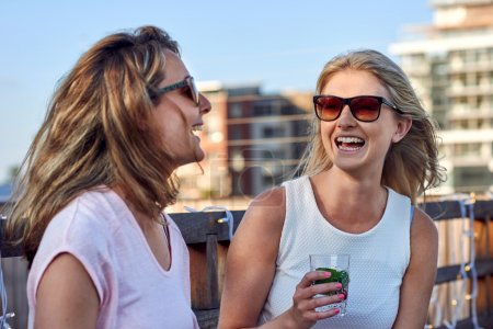 women chatting laughing outdoor