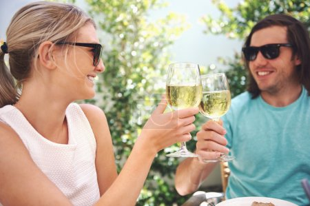 Couple drinking white wine at lunch