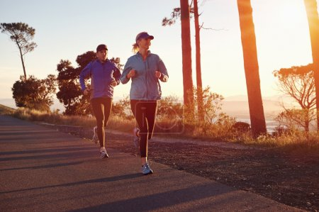 Couple Running at sunrise