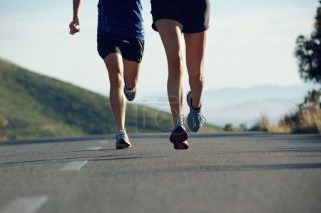 Fitness exercising couple training for marathon ru...