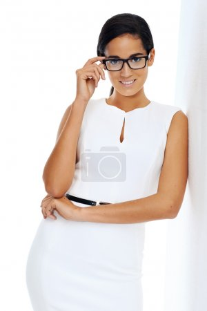 businesswoman with glasses leaning next wall
