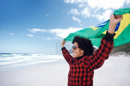 Photo for Portrait of young Brazilian man with Brasil flag supporting soccer team for world cup - Royalty Free Image