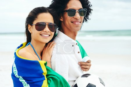 Photo for Portrait of latino couple with Brasil flag and soccer ball for world cup - Royalty Free Image