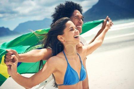 hispanic couple hold flag