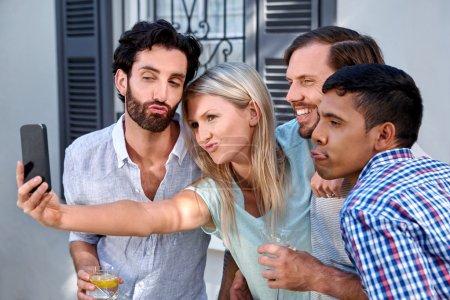 Friends taking selflie at garden party