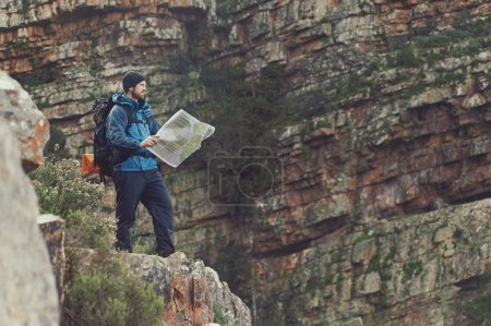 Man with map exploring wilderness