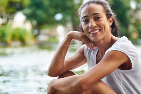 Photo for Portrait of young beautiful smiling female near the lake - Royalty Free Image