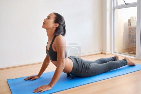 woman practicing indoor yoga