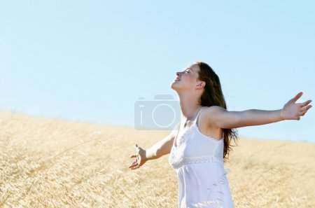 Summer freedom woman in field