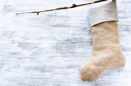 Handmade christmas stocking made of hessian and cloth