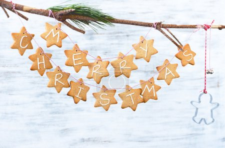 Star christmas cookies with gingerbread man cutter and bells