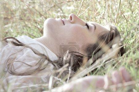 Girl lying in the grass