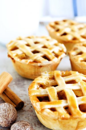 Photo for Golden brown rustic pies with fruit filling and spices - Royalty Free Image