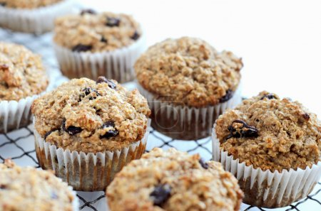 Photo for Healthy freshly baked wholewheat bran muffins on cooling tray - Royalty Free Image
