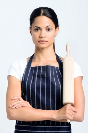 Serious baker holding a rolling pin