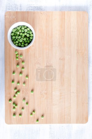 Photo for Vegetable fresh peas on bamboo chopping board from overhead, food background - Royalty Free Image